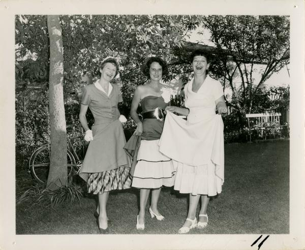 Mary Horn, Fay Powell, and Lorraine Vosper pose at Library staff party