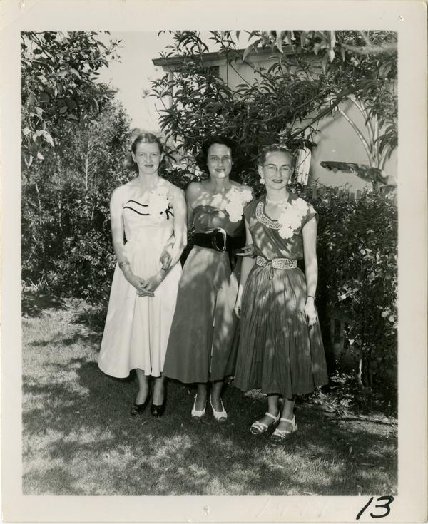 Fay Powell poses with two guests at Library staff party
