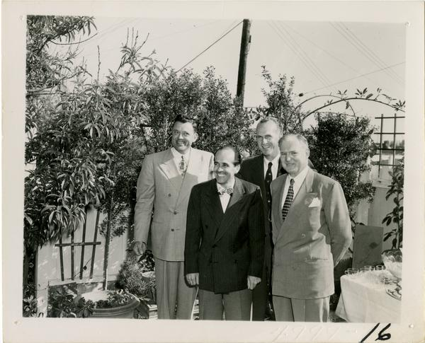 Paul Dodd, Lawrence Clark Powell, Harold Hamill, and John Henderson at Library staff party