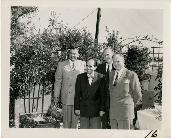 Paul Dodd, Lawrence Clark Powell, Harold Hamill, and John Henderson at Library staff party