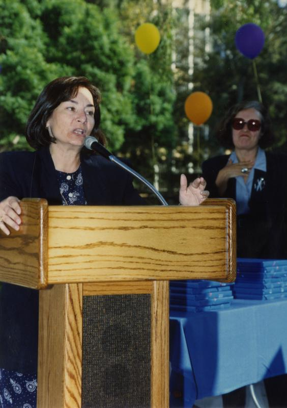 Library staff member speaking at retirees party, ca. 1991