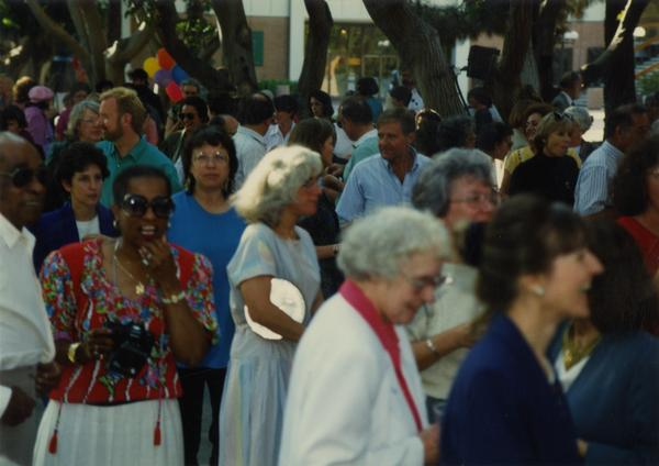 Crowds at a library staff party, ca. 1991