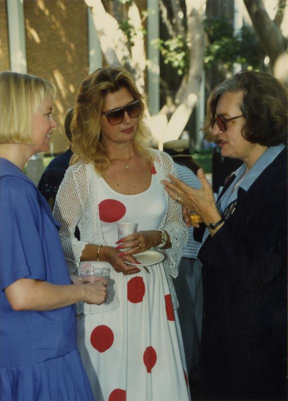 Library staff talking to each other at a party, ca. 1991