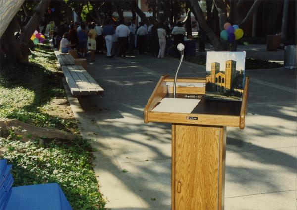 Podium at a library staff party event, ca. 1991