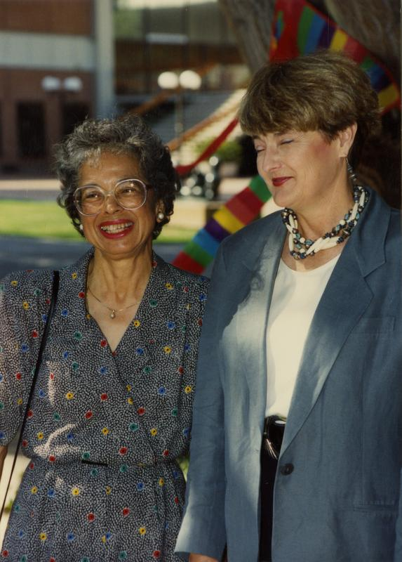 Two library staff members pose for a photo at a staff event, ca. 1991
