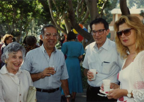 Library staff members smile for the camera at a staff event, ca. 1991