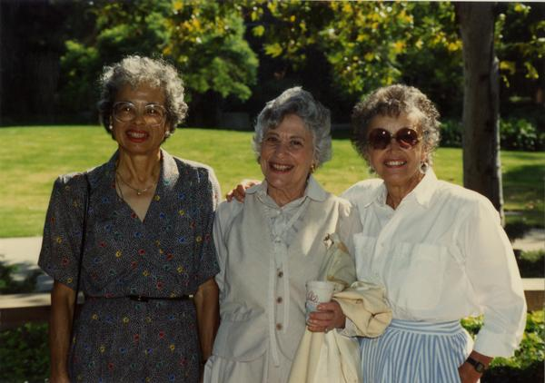 Three library staff members pose for a photograph, ca. 1991