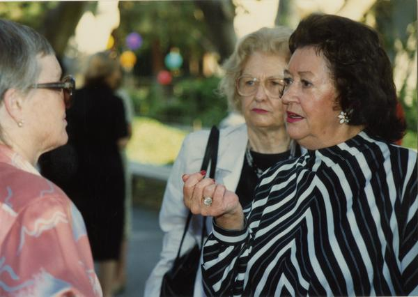 Library staff members talk with each other at a staff retirement party, 1991