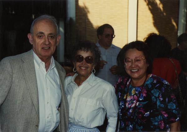 Library staff pose for a photograph at a staff retirement party, 1991