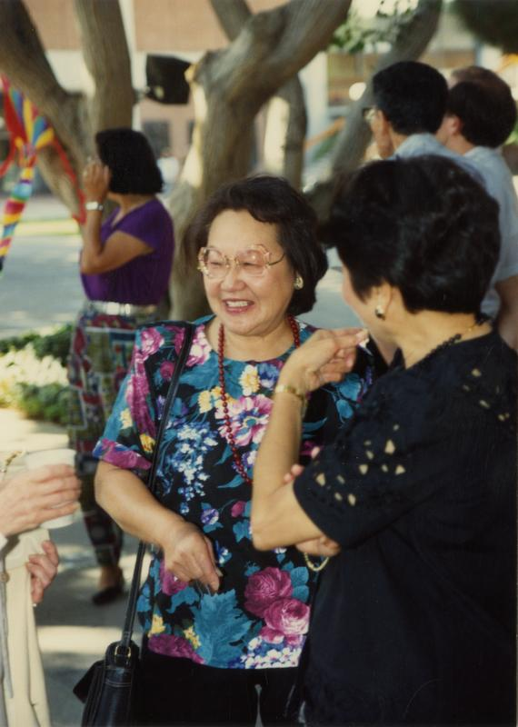 Candid shot of library staff laughing at a staff retirement party, 1991
