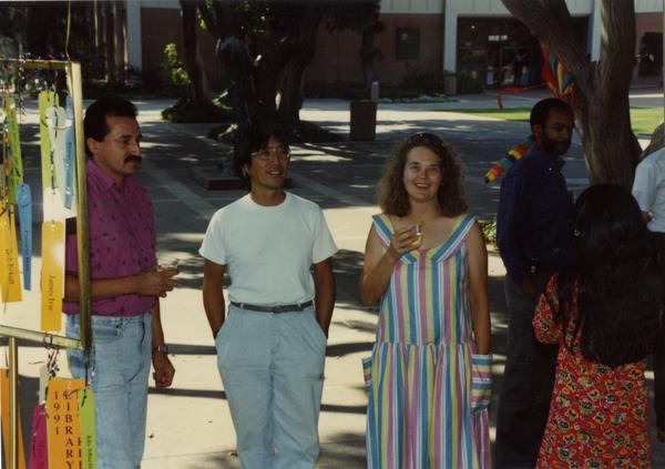 Various library staff members standing around at a staff retirement party, 1991