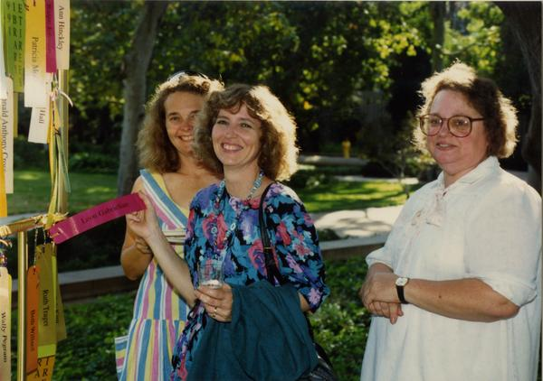 Library staff smile for the camera at the staff retirement party, 1991