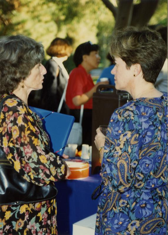Library staff talk to each other at a staff retirement party, 1991