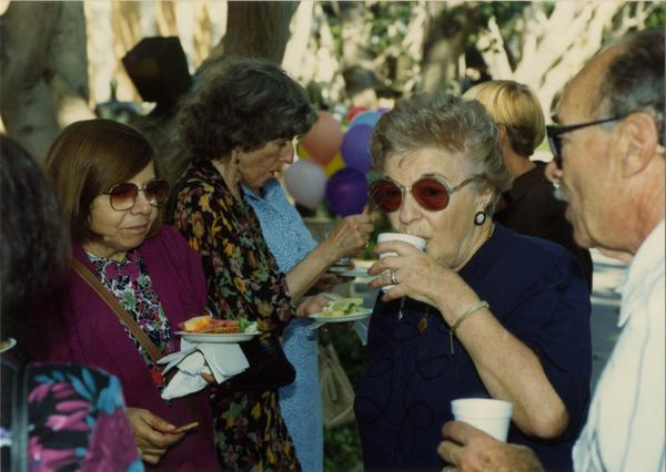 Library staff members eat at the staff retirement party, 1991