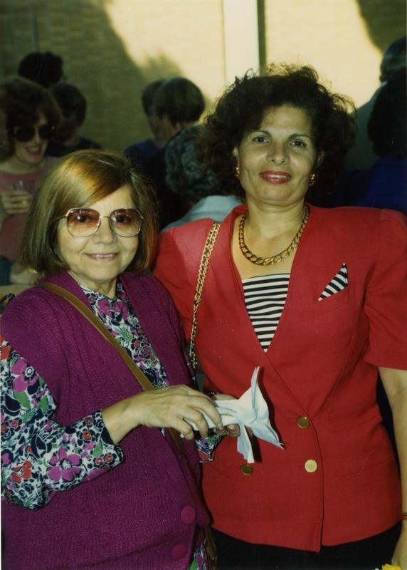 Two female library staff workers pose for a photograph at the staff retirement party, 1991