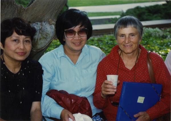 Library staff pose for a photograph at the staff retirement party, 1991