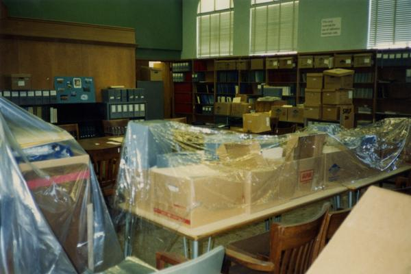 Unpackaged funiture in room 390 in Powell Library, ca. 1990's