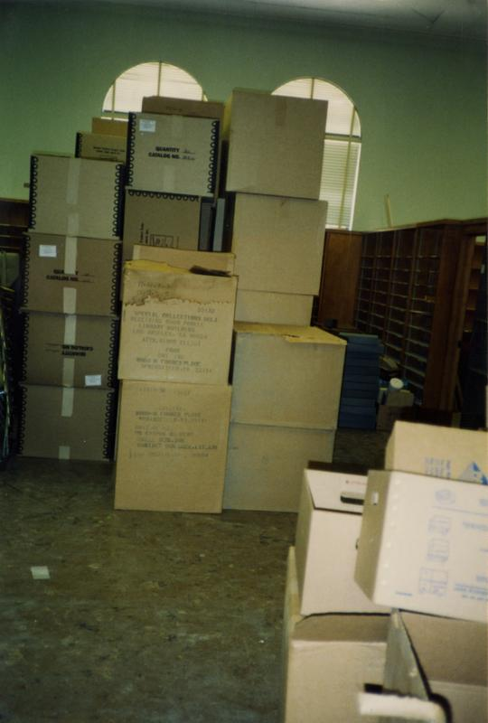 Stacked boxes in room 390, Powell Library, ca. 1990's