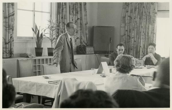 Lawrence Clark Powell addresses a crowd on a trip to Japan, ca. 1960