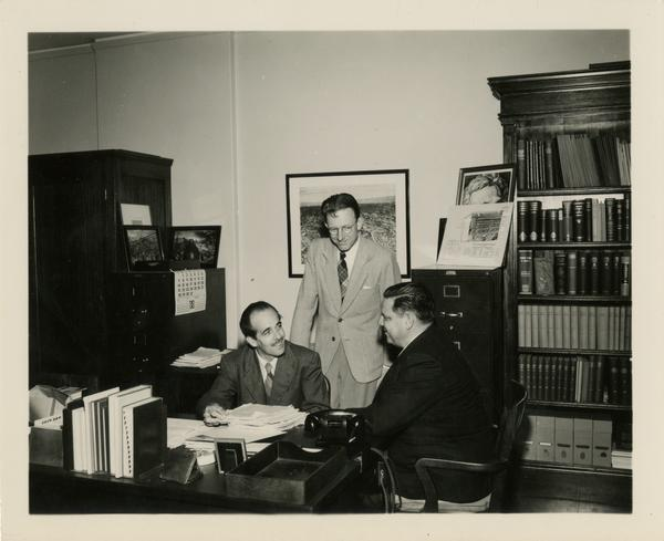 Lawrence Clark Powell talks with other faculty members of the School of Library Service