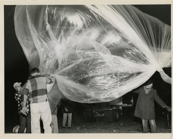 A giant sky-hook ballon used to carry a lot a package of nuclear emulsion plates used in cosmic ray studies is prepared for launching at the Los Alamos airport