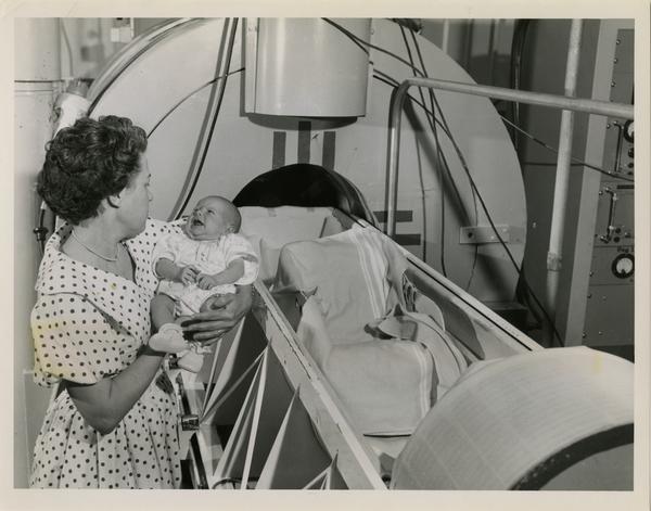 A young Los Alamos citizen prepares to enter the Whole Body Liquid Scintillation Counter