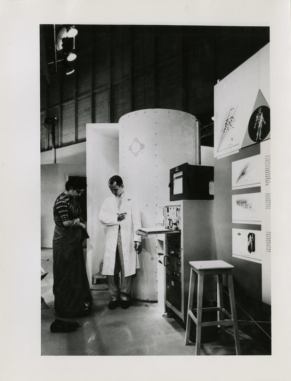 Scientists at the Los Alamos Scientific Laboratory standing next to equipment