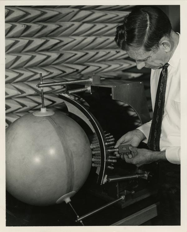 Man adjusts Luneberg Lens