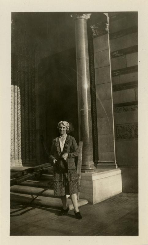 Woman in front of Royce Hall where art department is located