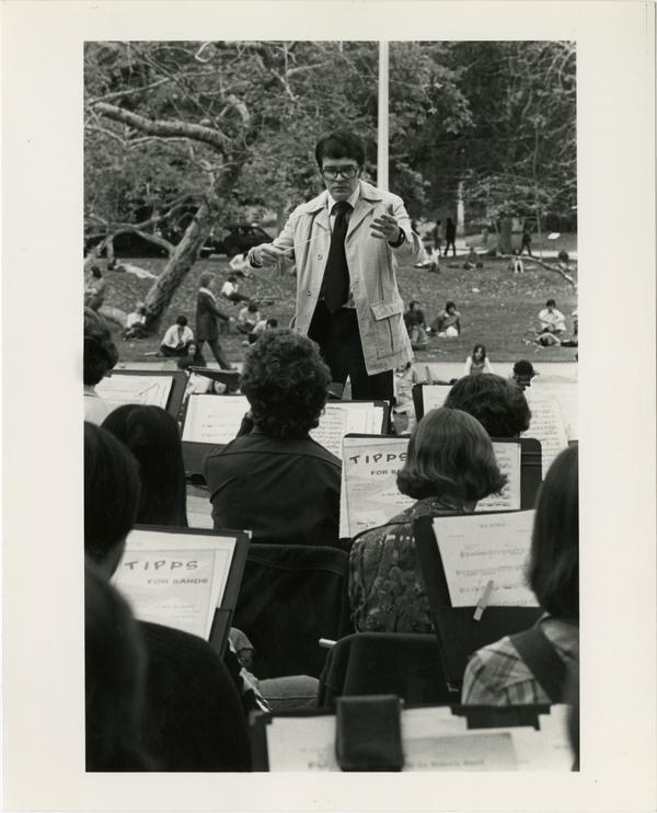 View of conductor during musical performance outdoors