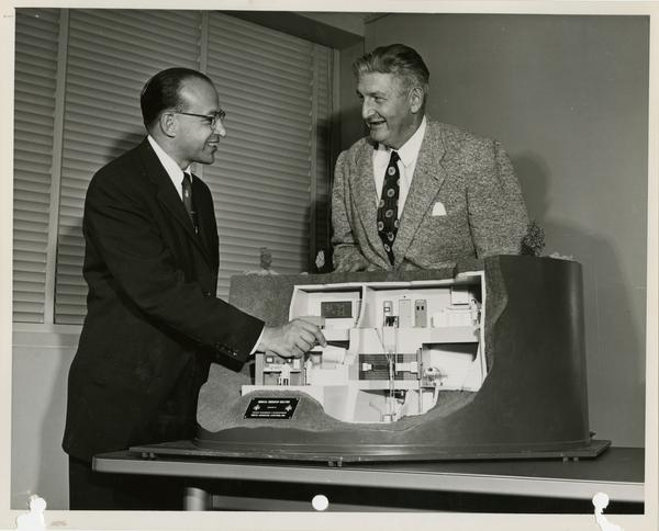 Dr. Chauncey Starr and Dr. Stafford L. Warren with first atomic energy reactor, ca. 1955