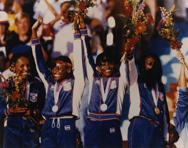 Sherrie Howard (second left) & other members of gold medal 1600-meter women's relay team on the Victory Stand.