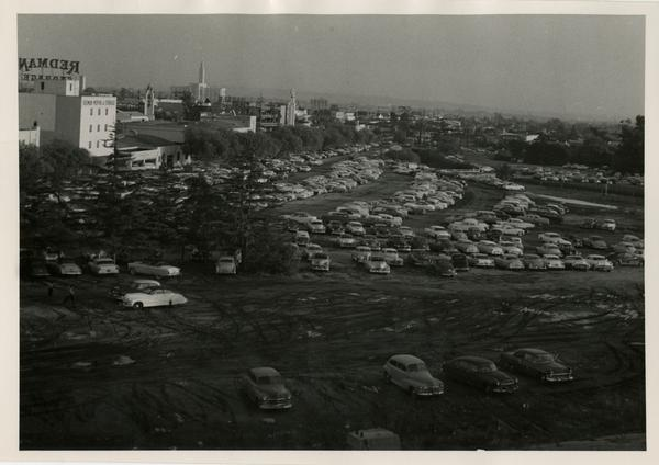 Cars parked on a dirt lot