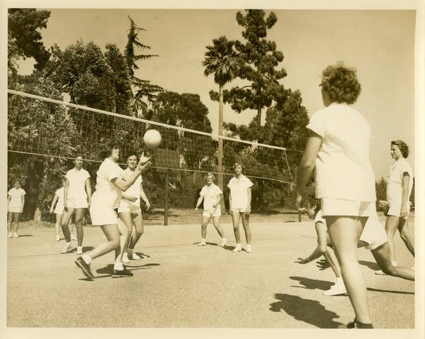Women playing volleyball