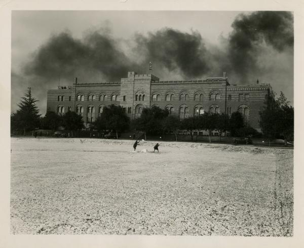People playing in snow in front of Kinsey Hall, January 11, 1949