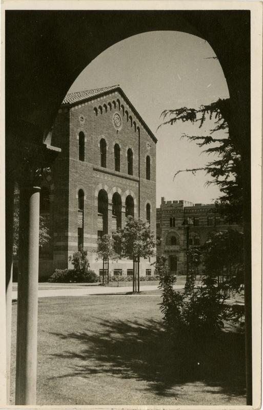 View of Kinsey Hall through arcade of Royce Hall, ca. 1942