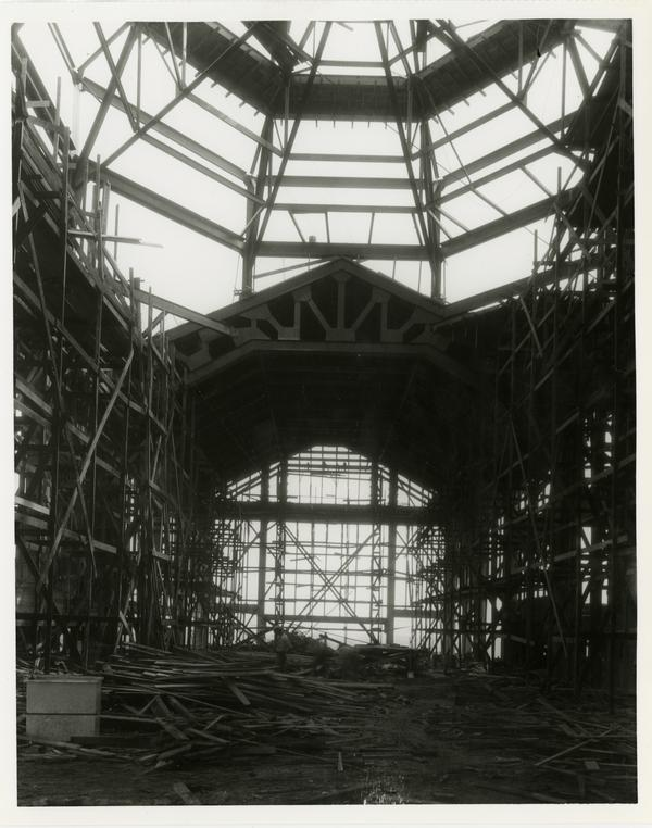 Interior view of Powell Library during construction