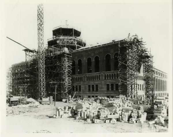 North façade of Powell Library during construction, ca. 1928