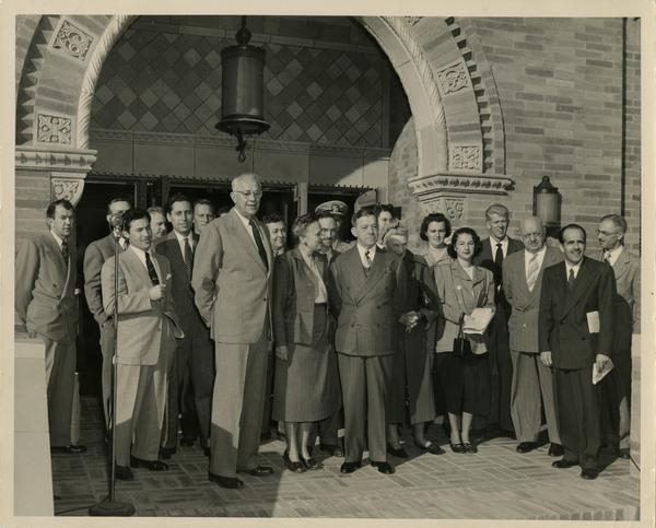 Dykstra, Dickson, Powell among crowd gathering outside of Powell Library east wing at dedication ceremony, ca. 1948