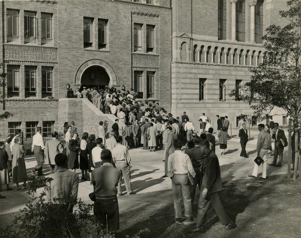 Crowd enters the newly opened east wing of Powell Library