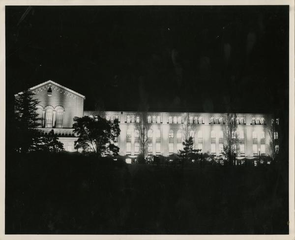 Powell Library lit up at night