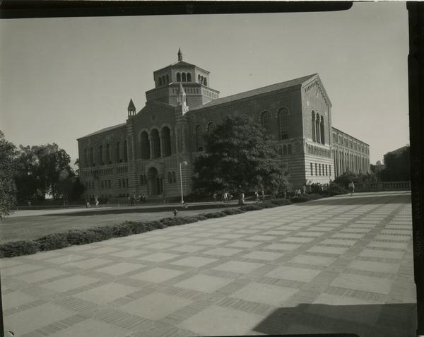 View of Powell Library as students walk by, ca. 1966