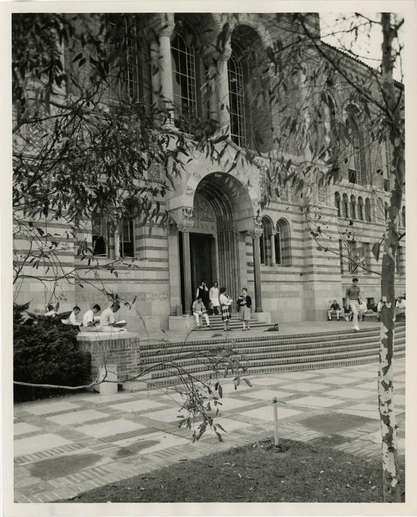Students standing outside of Powell Library entrance