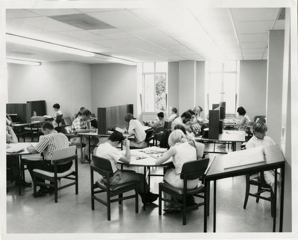 Students studying in Powell Library, ca. 1966