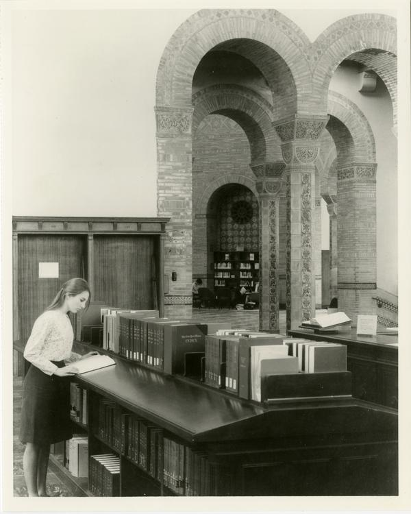 Student researching in main reading room