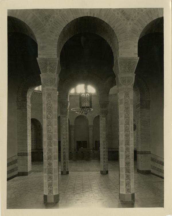 Interior view of Powell Library loan desk behind arches, ca. 1929