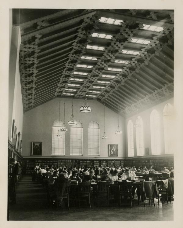 Students studying in main reading room of Powell Library