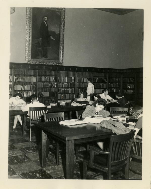 Students studying in reading room of Powell Library