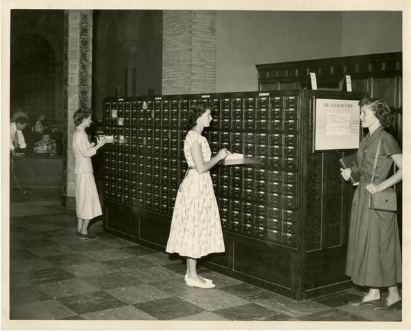 Students searching through card catalog, ca. 1950