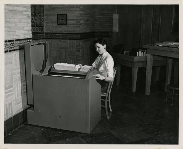 Woman searching through card catalog